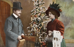 Vintage Christmas card circa 1915 shows the turn-of-the-century Christmas tree in Europe where most trees were 4ft tall. It was in the United States where trees from floor to ceiling were used.